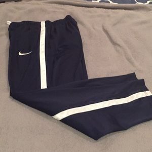 Boys navy blue Nike warm up pants with pockets